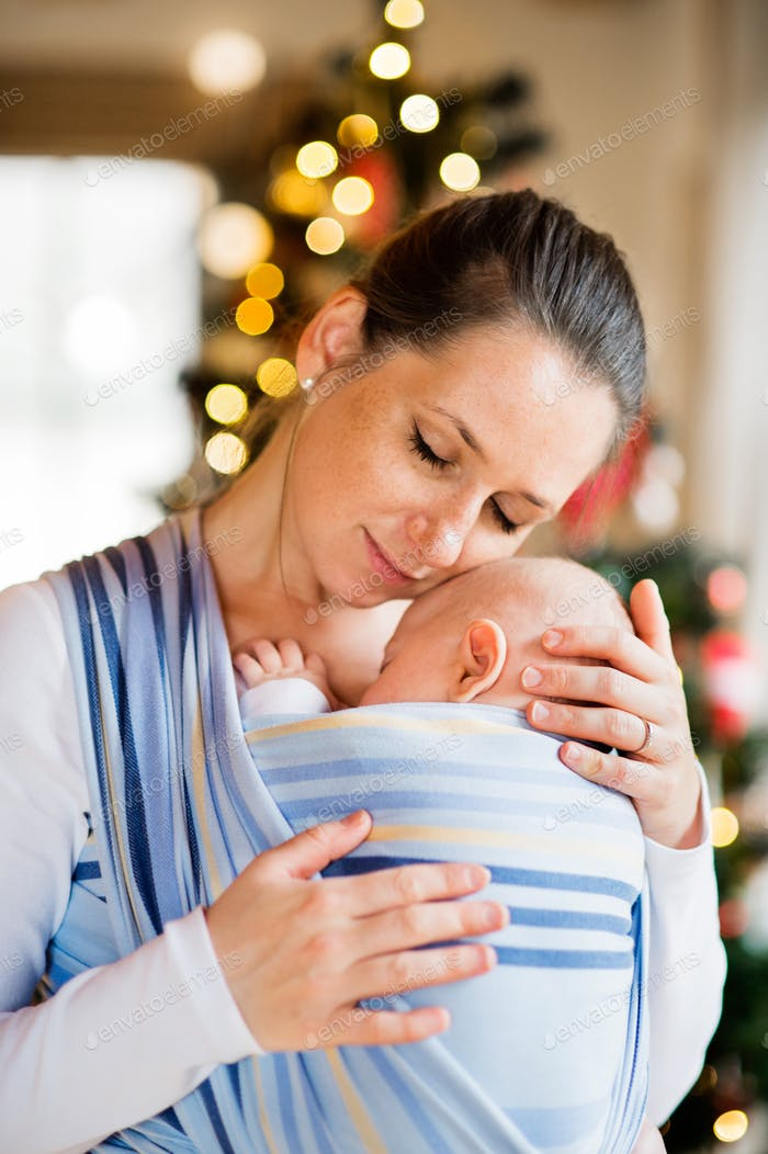 Young woman with a baby boy at Christmas time.