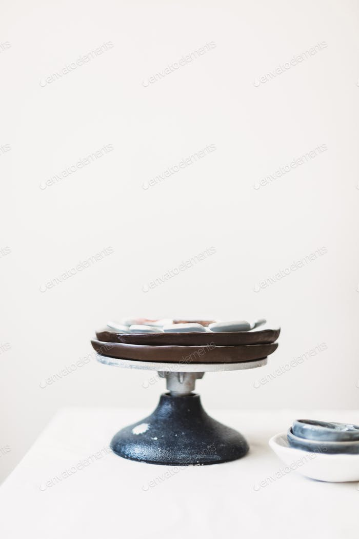 Close up handmade stand at pottery studio isolated