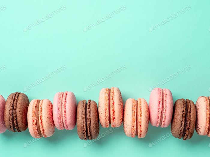 Macarons on turquoise, copy space top