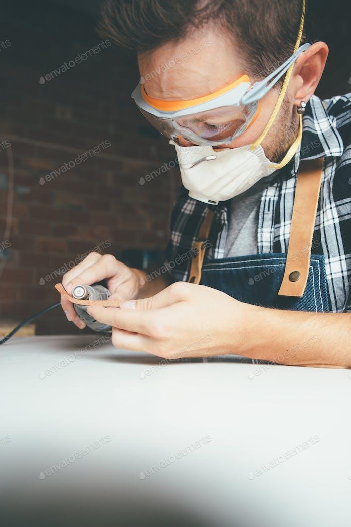 Man in eye protector at workshop