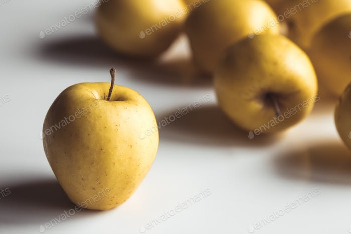 Yellow apples on a white background, wholesome food, farming, vegetarian