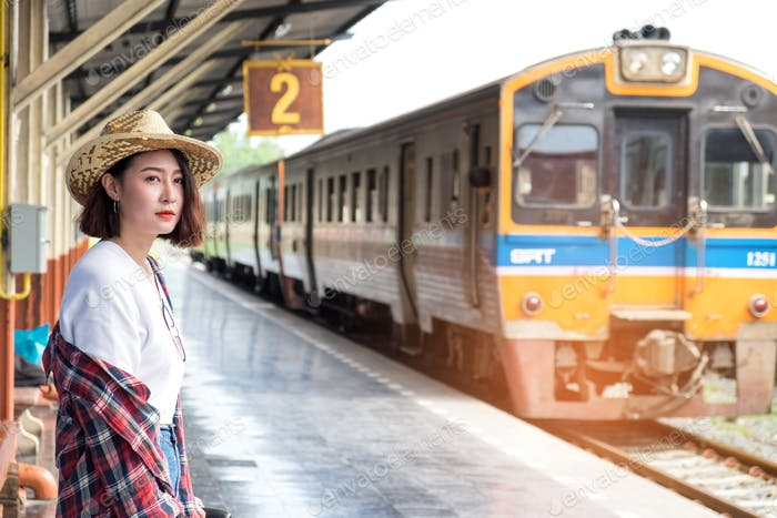 Asian female tourists Waiting for train.