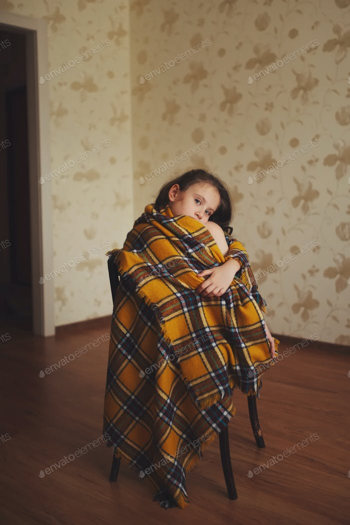 little girl with plaid at home