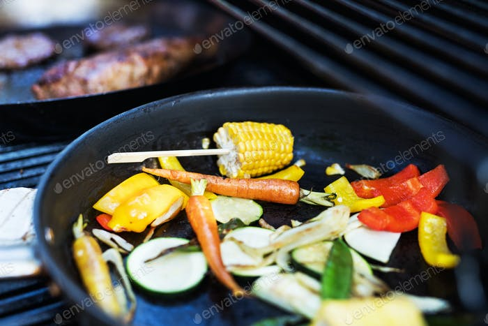 Vegetables on the grill. Garden party outside in the backyard.