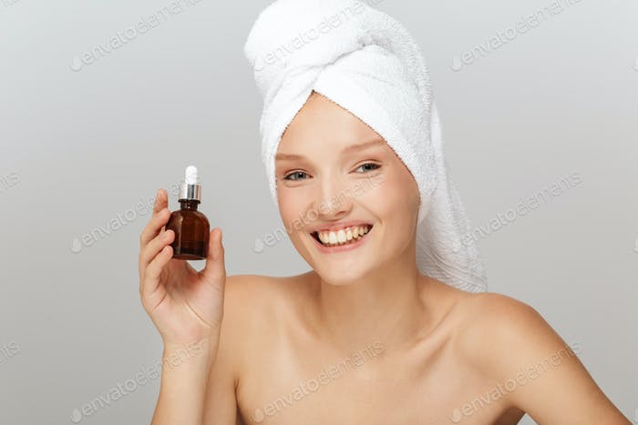 Portrait of young cheerful lady without makeup with white towel