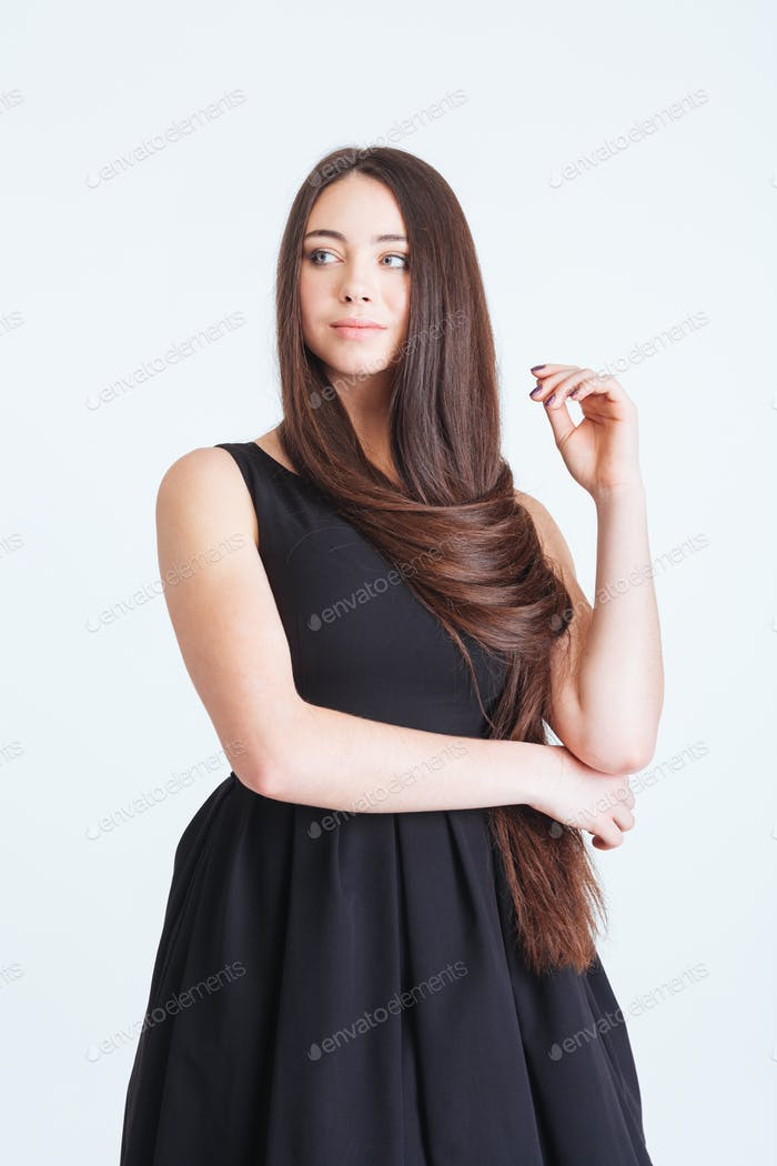 Confident pensive young woman with beautiful long dark hair