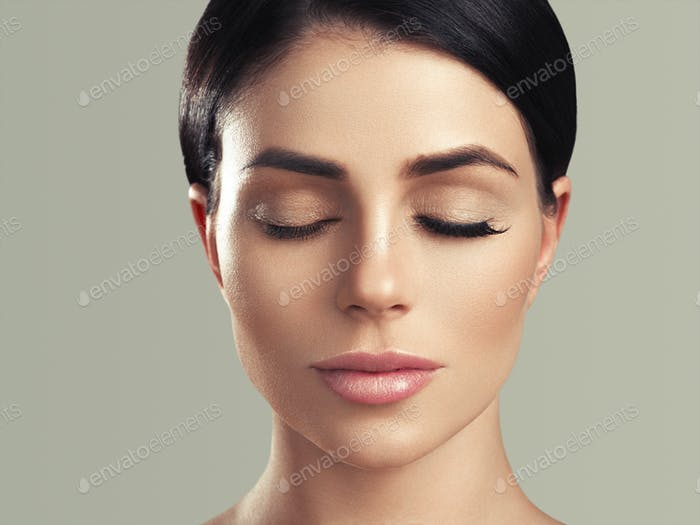 Beautiful woman healthy skin care concept portrait close up gray background. Studio shot.