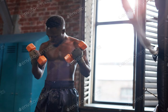 African athlete with dumbbells