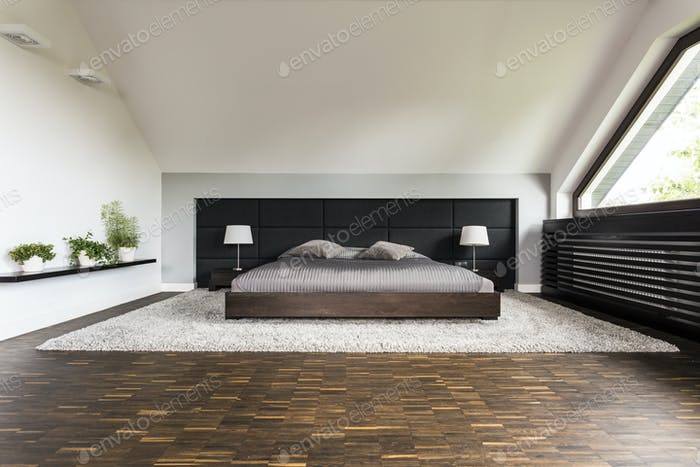Big bed in a bedroom