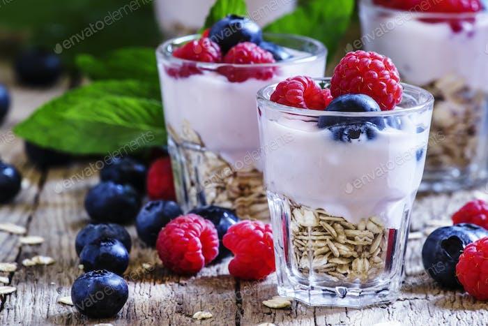 Sweet berry dessert with oatmeal, yogurt, blueberries and raspberries
