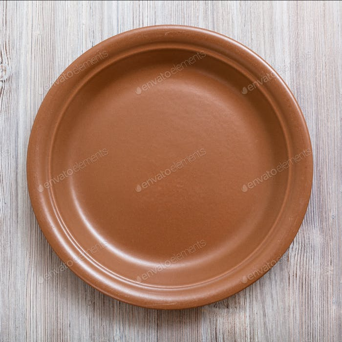 top view of brown plate on gray brown table