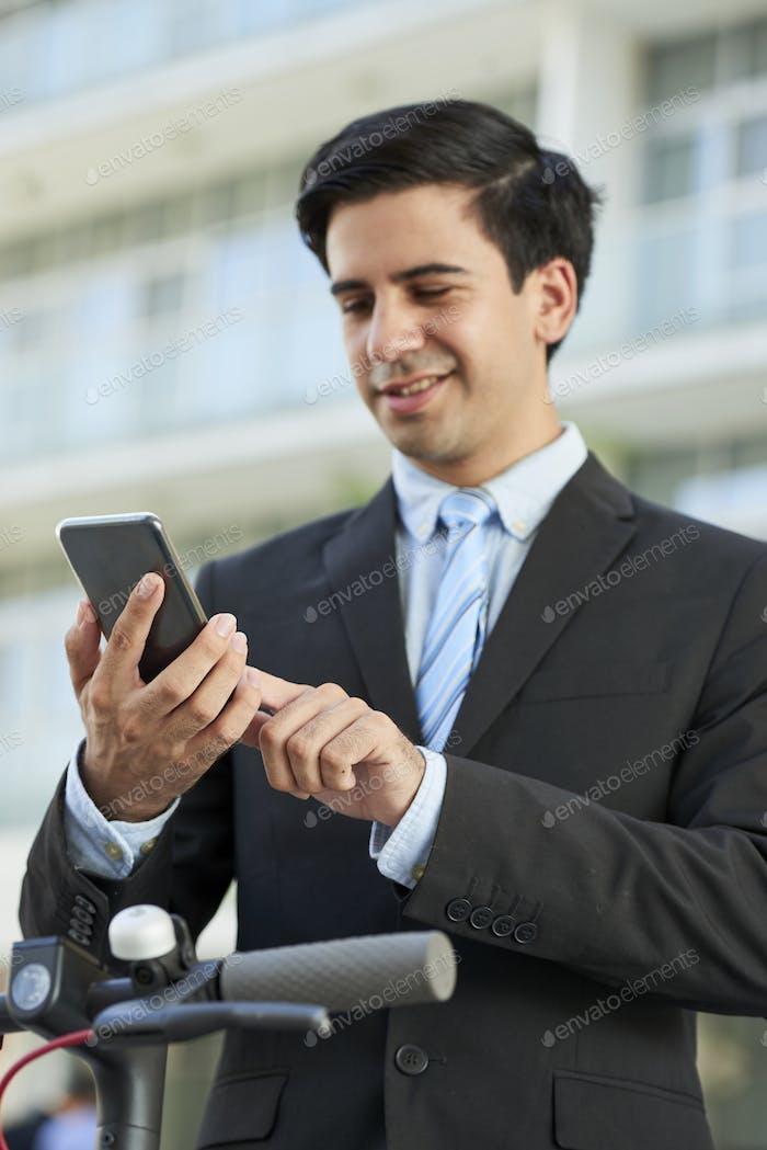 Entrepreneur sending text message