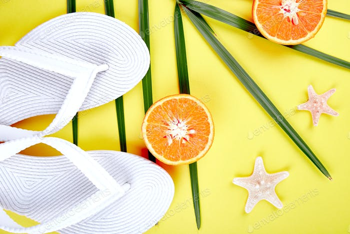 White Flip flops, Orange fruit, starfish and palm