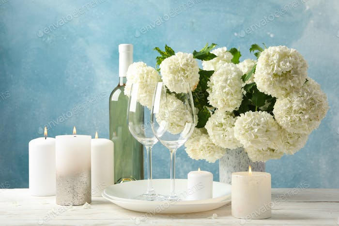 Composition with hydrangea flowers against blue background. Romantic evening