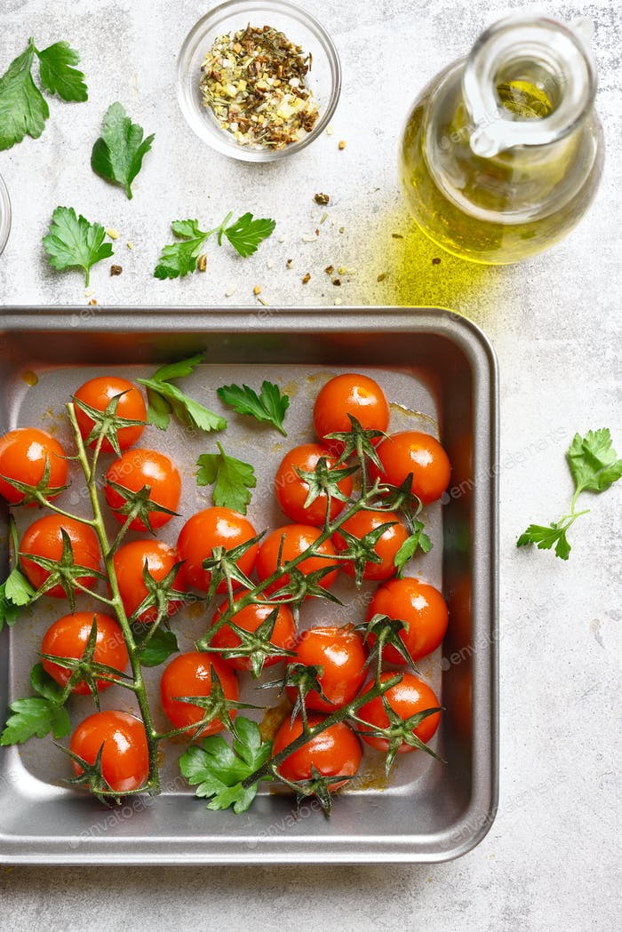 Baked cherry tomatoes in baking tray