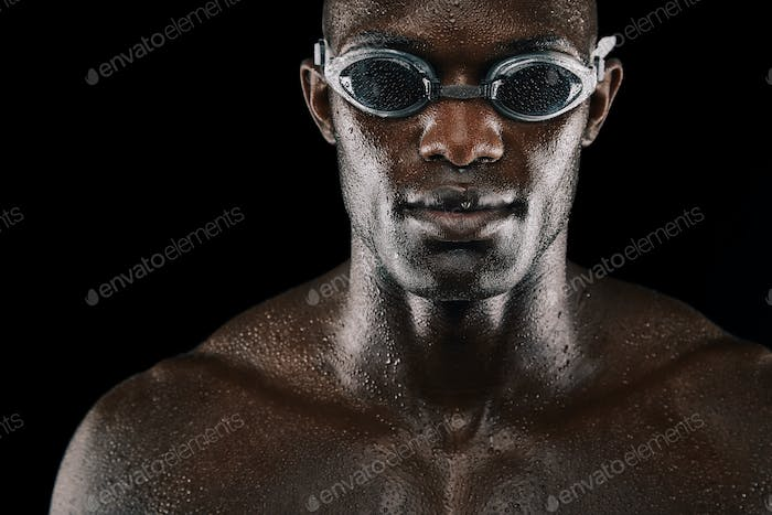 Young african man with swimming goggles