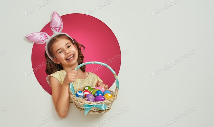 Girl with painted eggs