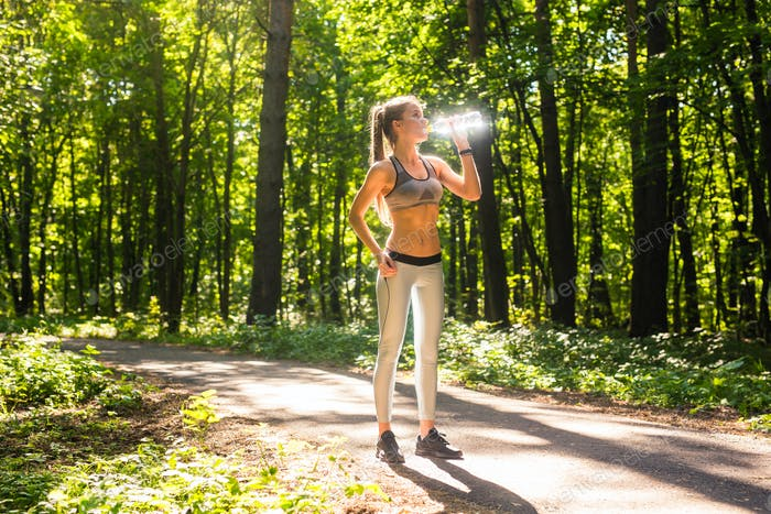 Fitness beautiful woman drinking water