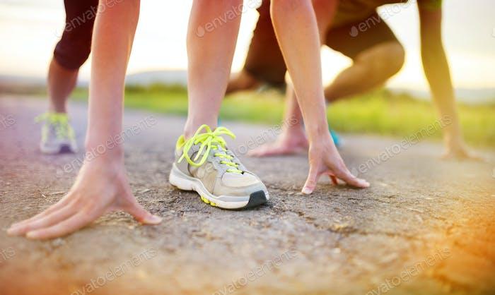 Couple running feet closeup