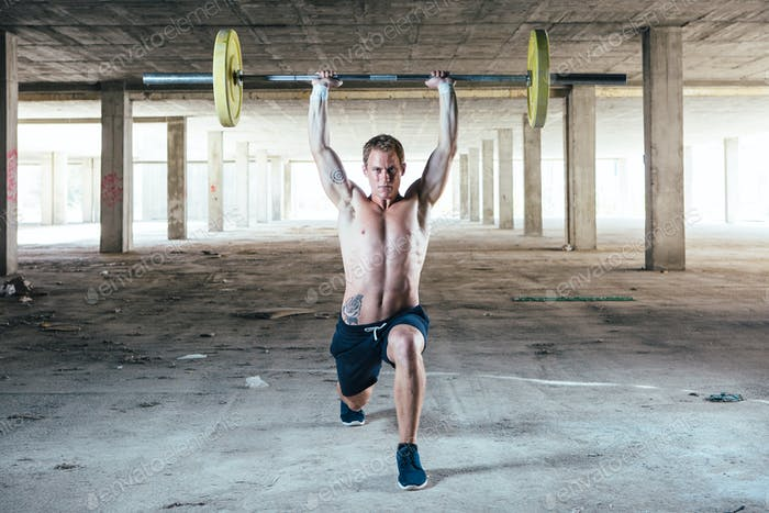Man holding barbell overhead
