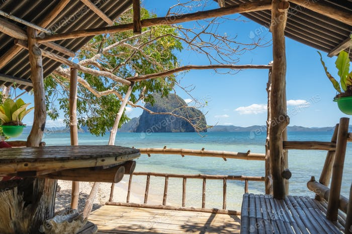 Beautiful Las Cabanas Beach. Veranda made entirely of wood. El Nido, Palawan, Philippines