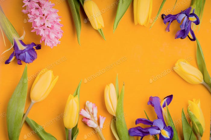 Frame of flowers on a yellow background