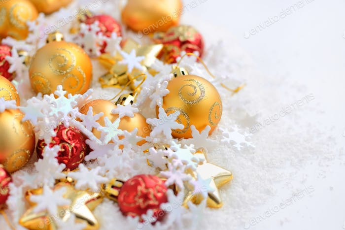 Composition of the Christmas decorations on snow with space for