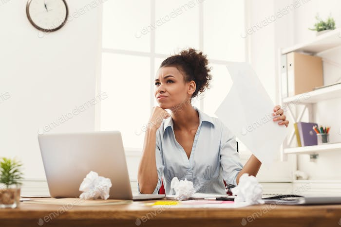 Angry business woman reading document at office desktop