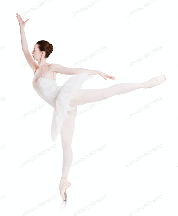 Ballerina makes ballet position arabesque isolated on white background