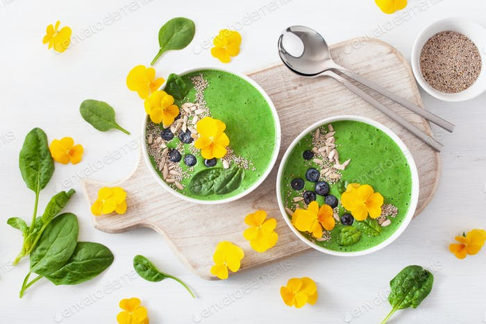 green spinach smoothie bowl with blueberry, chia seed and edible