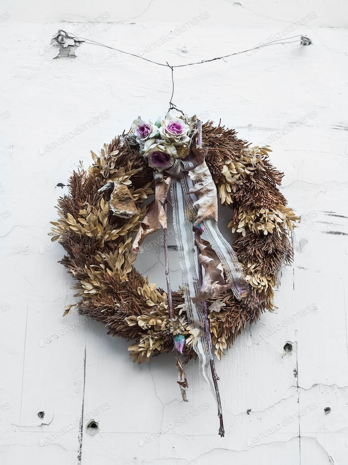 Holiday wreath on the white door