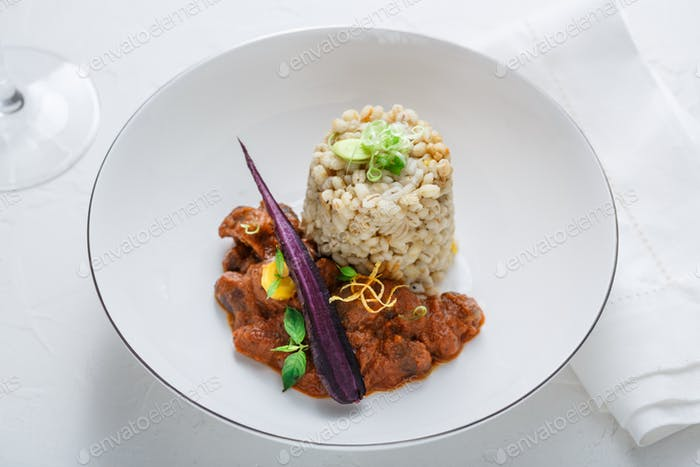 Stewed chicken hearts with barley