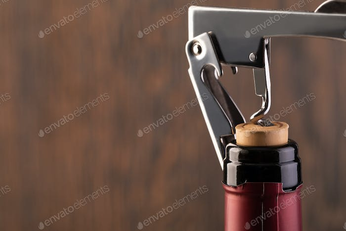 Corkscrew and bottle of wine