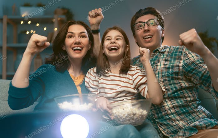Happy family watching projector