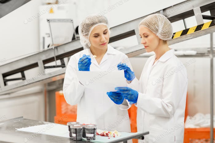 women technologists tasting ice cream at factory