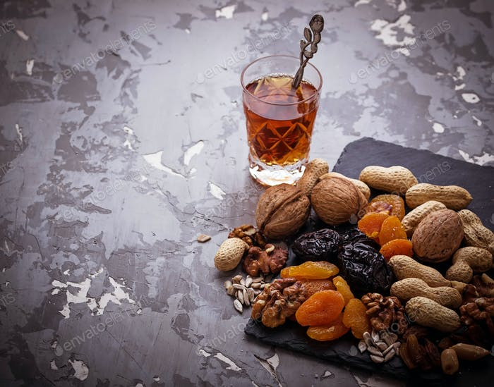 Traditional arabic tea and dry fruits and nuts