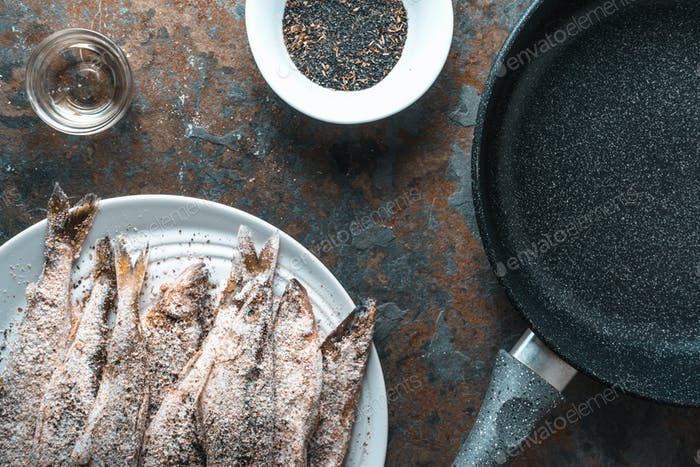 Frying pan, smelt on the plate, salt and spices