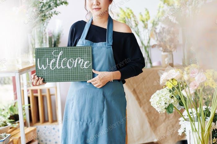 Saleswoman welcoming new customers