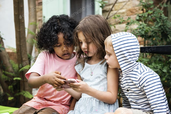 Children playing games on a smartphone