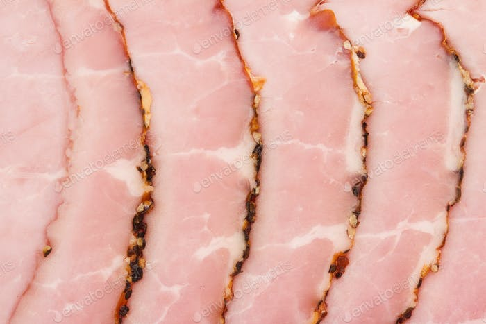 slices of smoked pork fillet pink texture background