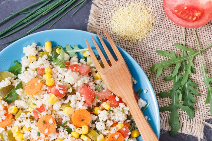 Fresh salad with couscous and vegetables as best nutritious food
