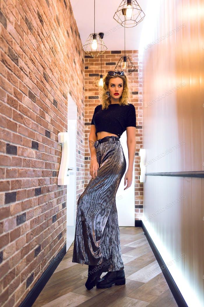 Indoor elegant portrait of young blonde sexy model