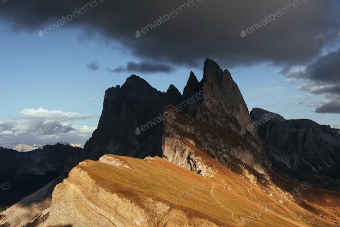 Into the darkness. Outstanding hills of the Seceda dolomite mountains at daytime