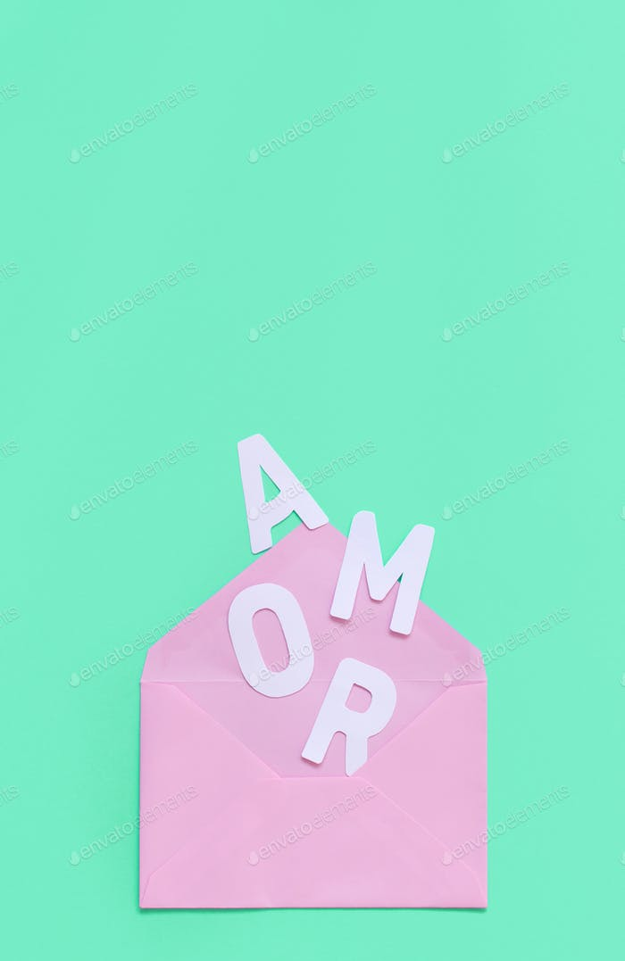 Pink envelope and text AMOR on a light green background