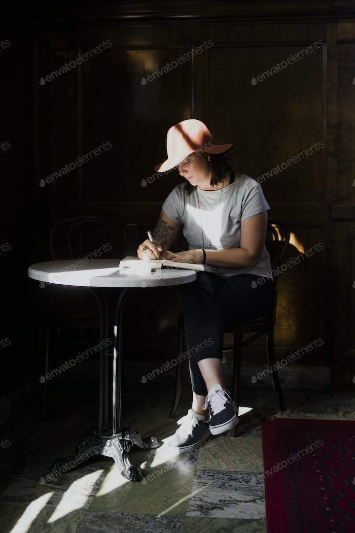 Freelancer working at table in cafe