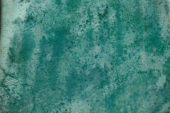 Grunge verwitterte und gebeizte alte grüne Mauer