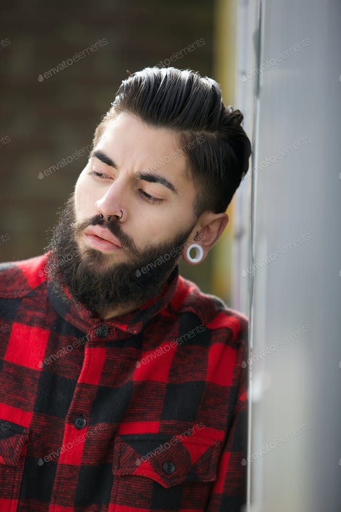 Funky guy with beard and piercings