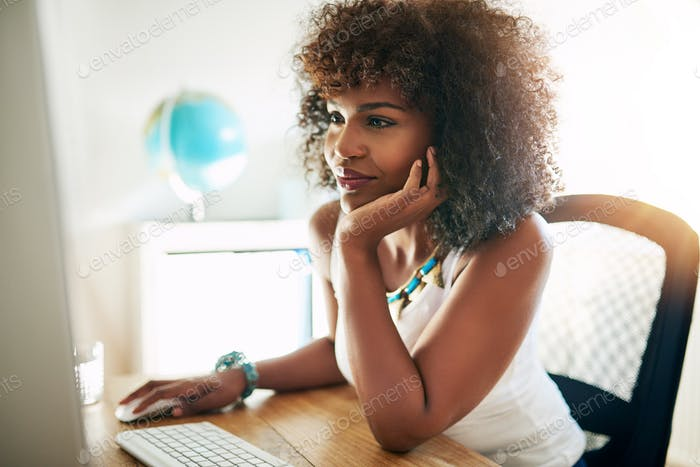 Young black girl working on computer