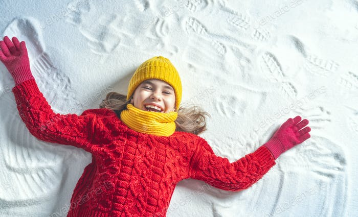 Kid making snow angel.