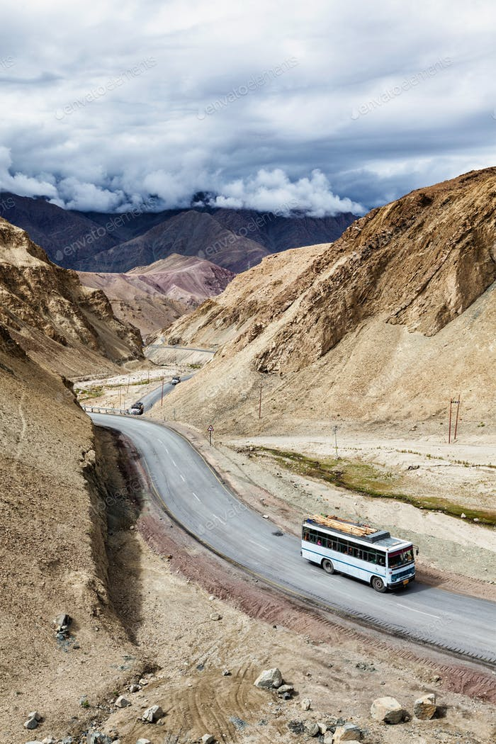 Indian passenger bus on highway in Himalayas. Ladakh, India
